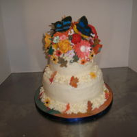 Fall Butterfly Wedding Wedding cake with fall flowers and butterfly toppers