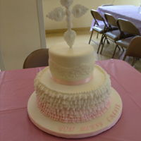 First Communion Cake Lemon Velvet Cake w Lemon Curd filling covered with Lemon BC Ombre ruffles. Top tier is a dummy covered in MFF with fondant lace. The Cross...