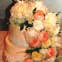 Floral Cascade Ivory textured buttercream with lace and pearl borders with a fresh floral cascade.