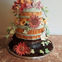 Flower Basket Wedding Cake The bride wanted a rustic cake. Bottom is German chocolate and top two cake are red velvet.