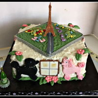 French Theme Birthday Eiffel tower, pink & black poodles looking in the window.Lemon cake, raspberry filling & orange flavored BC frosting. All...