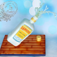 Gin Bottle Gin bottle is a chocolate cake and i used isomalt to create gin coming out of the bottle ;) all edible