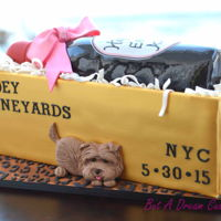 Glam Wine Bottle Cake   Wine bottle cake in a golden crate and leopard board.