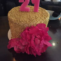 Gold Pearl Cake With Hot Pink Peonies   Buttercream covered in gold pearls with big pink flower