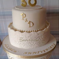 Golden Anniversary Cake   Ivory and gold two tier chocolate fudge and lemon cakes