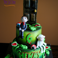Goosebumps This is a Goosebumps themed two tier covered in fondant with fondant accents...eyeballs, venus flytraps, etc. Slappy & the abominable...