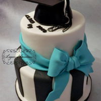 Graduation Cake Two tier with black strips, graduation cap and bow