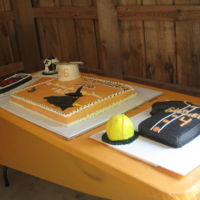 Graduation Cakes main cake , mortar board hat, stealth airplane, saxaphone also a softball jersey and softball then a Helmet from Robotic clubplus a...