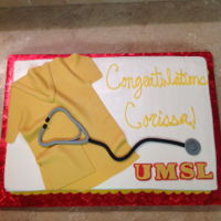 Graduation Nursing School Cake Half sheet cake with the scrubs shirt, and stethoscope made out of fondant.