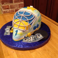 Grooms Cake Made this Goalie Hockey Helmet, all cake then covered with fondant the photos were printed to look like film strips then printed on edible...