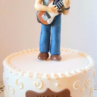 Guitar Man   Chocolate cake with strawberry buttercream filling iced with vanilla Swiss meringue