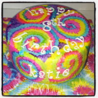 Hand Painted Tie Dye Cake This was a fun cake to make. Covered with white mmf then handpainted the tie dye pattern on. Tie dyed the batter to match!