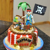 Jake The Pirate Cake All decorations are edible and made with marshmallow fondan.