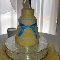 Lace Wedding Cake   4 Tier French Vanilla cake with a Strawberry filling. The cake was dressed in vanilla fondant and trimmed in lace.
