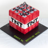 "Minecraft Tnt Cake For my son's 7th birthday. The cake was baked in a 7"" tin, and is comprised of four chocolate cakes filled with ganache and..."