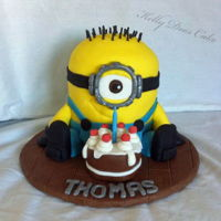 Minion Sculpted minion cake for my friends little boy. He pointed out to me his name doesnt have a capital huh (H) in it. The mini cake was...