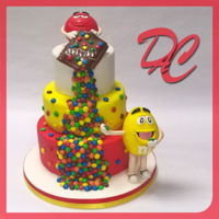 M&m's Bday Cake Thre layers chocolate Mud Cake filled with white chocolate ganache and strawberries.