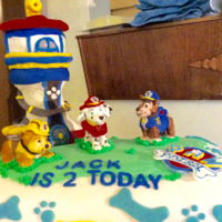 Paw Patrol Paw patrol cake make with chocolate fudge frosting and filling. Tower made of Rice Krispies and a mini cake. Cover in homemade fondant....