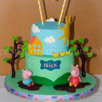 Peppa Pig Cake Peppa Pig cake for my son's 6th Birthday. Most of the decorations were made out of modelling chocolate, sooooo much easier to work...