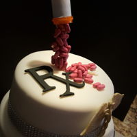 Pharmacist Cake/graduation Three tier cake buttercream with fondant covering, gumpaste cadeuses, good n plenty pills