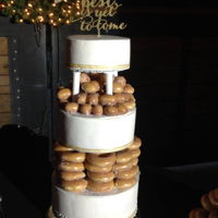 Phillips Wedding 3 tier with spacers filled with donuts and donut holes. Cream cheese almond pound cake with buttercream frosting.