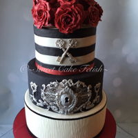 Red, Black And White Wedding   I truly love this design. This is my favorite wedding cake to date! The theme of the wedding was retro and Key to happy marriage!
