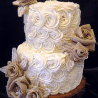 "Rosettes & Burlap Wedding Cake I made this for my besties wedding along with 10-8"" cakes that were on round wood slabs as the centerpieces. All together I made 36..."