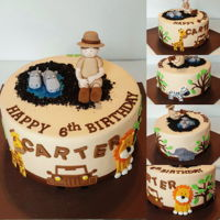 Safari Birthday Cake Safari themed birthday cake. The birthday boy wanted himself on top wearing safari clothes and sitting in a pile of dirt...haha! I'm...