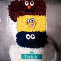 Sesame Street No. 1   vanilla cake with champagne flavored buttercream. Decorations are fondant and rice paper.