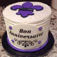 Small French Themed Birthday Cake This birthday cake was for a friend who taught French. I stenciled the plaque using a stencil I cut with my Cricut, and cut the fleur de...