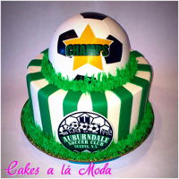 Soccer Ball Cake Fondant cake, soccer ball tiles individually cut out of fondant and pieced together.