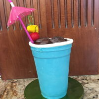 Solo Cup Cake Solo Cup made of chocolate filled with chocolate cake icing and ganache. Isomalt ice cubes fondant cherry and pineapple