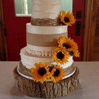Sort-Of-Rustic Wedding My first wedding cake, and although I wish the florist had left different sizes of flowers, I was so relieved when it was done that I didn...