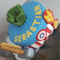 Superhero Cake Avengers cake, hulk fist made of modeling chocolate, thor hammer made of rice krispie treats, and Captain America shield and iron man mask...