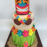 Tiki Hawaiian Cake All edible! Feeds about 40 people.