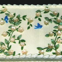 Vines And Blossoms White textured buttercream with gumpaste ivory blossoms with pearl centers and gumpaste leaves creating a blossom and vine design with 3...