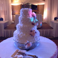 Wedding Cake This 4 tier cake was yellow cake with the entire cake covered in rosettes and fresh flowers cascading down.