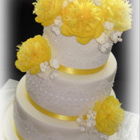 Wedding Cake In Yellow   With lace and yellow flowers from wafer paper