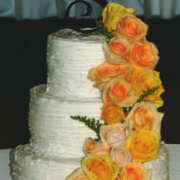 Yellow Rose Cascade White rustic buttercream featuring a fresh yellow rose cascade