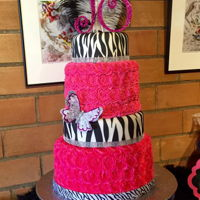 Zebra & Hot Pink Birthday Cake! I traveled home to collaborate with my sister on this cake. The zebra print cakes are dummy's since we didn't need that much cake...