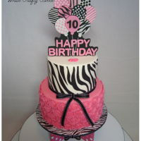 Zebra Stripes And Hot Pink Cake And Cupcake Tower Hot Pink and Zebra stripes for two beautiful young ladies celebrating their 10th Birthday. Fondant balloon topper and 80 individual molded...