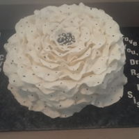 "10"" Peony White And Black Polka Dots Flower Cake  10"" Peony White and Black Polka Dots Flower Cake: (All Edible) Marble (Yellow/Chocolate) Cake in Vanilla Buttercream and decorated..."