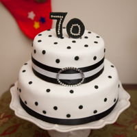 70Th Birthday Cake Vanilla Cake filled with Almond Buttercream and covered with White and Black Fondant