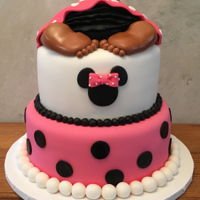 Baby Bottom Shower Fondant covered, two-tiered cake with baby bottom on top, pink blanket