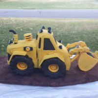 Backhoe Cake  This is a backhoe cake i made for my nephews 6th birthday. Even the scoop has cake inside. This was made with chocolate cake and covered in...