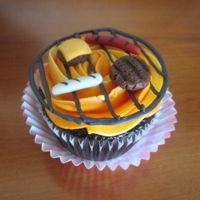 Bbq Cupcake Chocolate cupcake with vanilla SMBC, candy melt grill, fondant burgers and dogs.