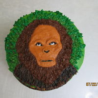 Bigfoot / Sasquatch Cake Vanilla Cake decorated with all Vanilla Buttercream, except small chocolate rocks. The large rock is buttercream. (I'm pretty sure the...