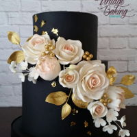 Black, Gold And Blush Floral Cake This is a black fondant cake with blush roses, peony buds, blossoms, gold rose leaves, buds and berries. Also flecked with bits of gold...
