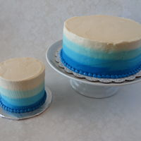 Blue Ombre Cake With Matching Smash Cake   Eight inch round in blue ombre buttercream with matching four inch round smash cake.