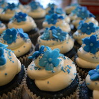 Blue Velvet Cupcakes Blue velvet cupcakes topped with SMB and fondant flowers